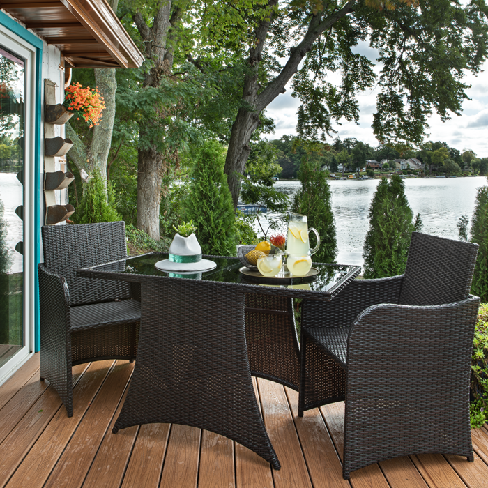 Turquoise trim, unique flower containers, copper accents, casual seating, and easy-care Trex composite decking create an inviting ambiance for the homeowner and her family and friends.